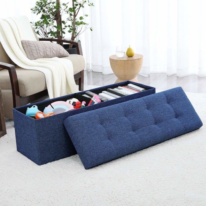 This ottoman is upholstered in a linen fabric, so it's super durable. The tufted, cushioned top makes it comfortable for lounging. Get it from Amazon for $32.99+ (available in three sizes, five colors, and two fabrics).