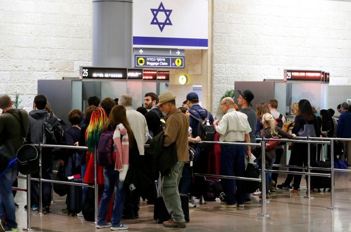 A picture taken on March 22 shows arriving passengers queueing to present their travel documents before passport control at Ben Gurion International Airport on the outskirts of Tel Aviv.