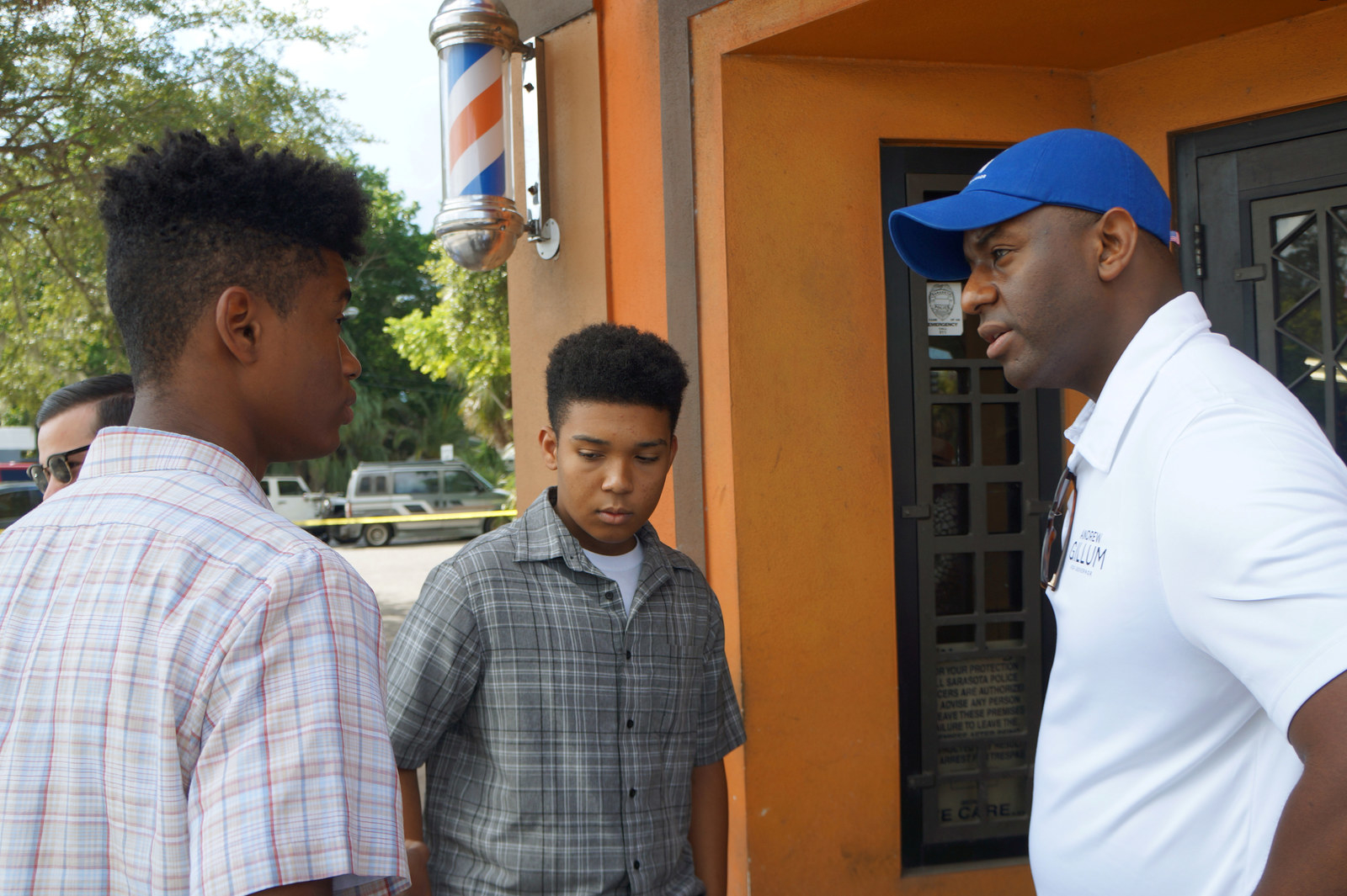 Gillum talking with voters on a tour of barbershops in Sarasota, Florida, on July 18, 2018.