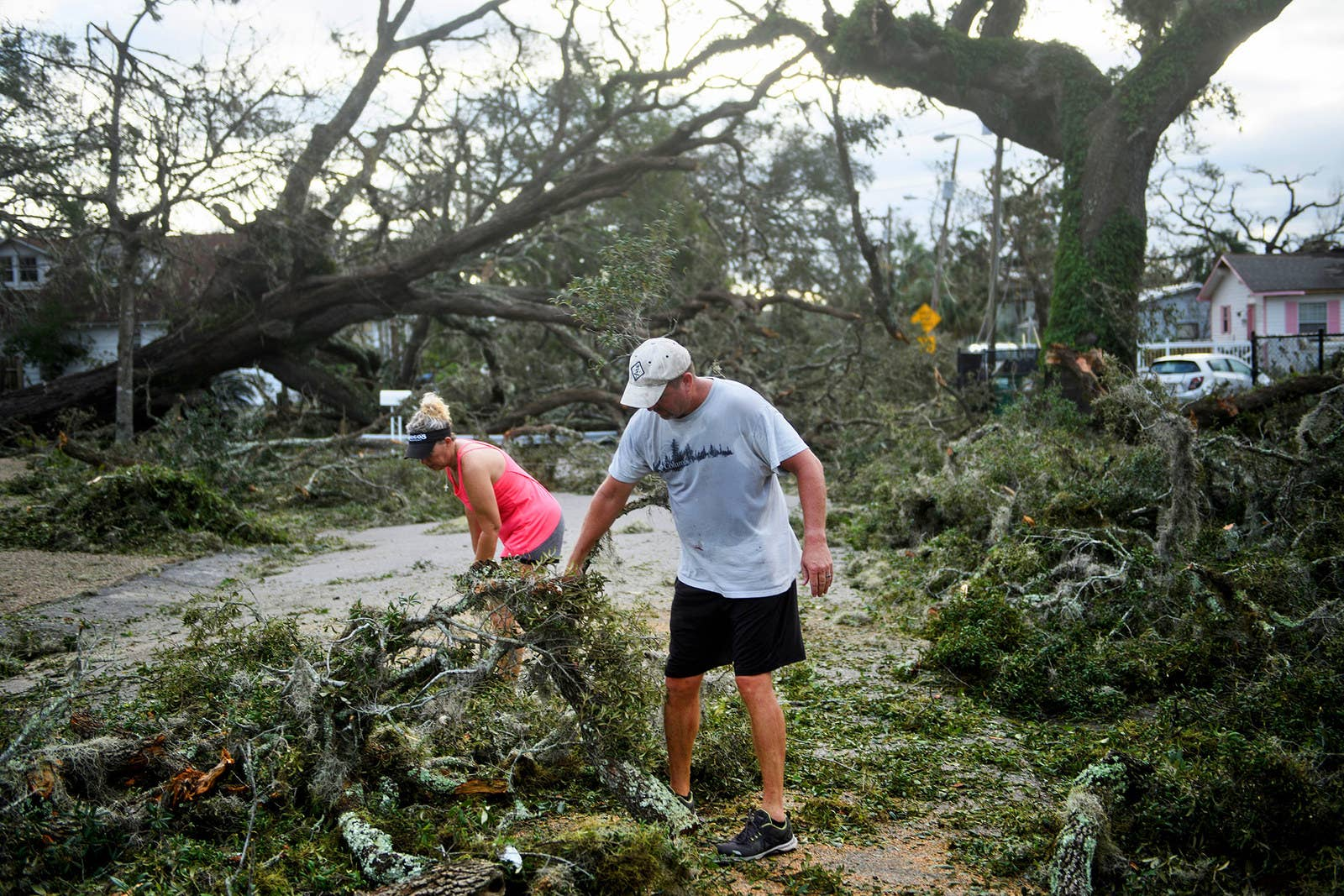 Residents clear a road of fallen trees in Panama City, Florida.