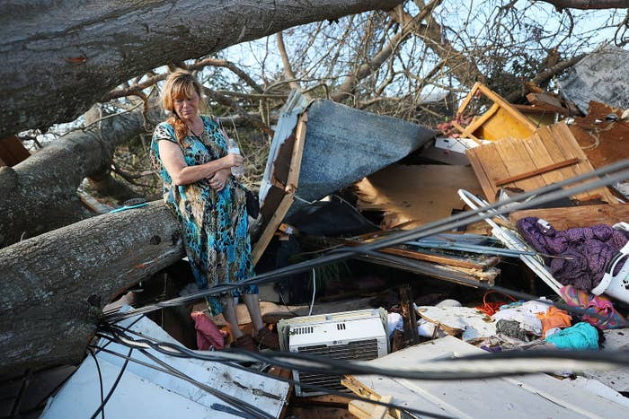 Kathy Coy stands amid what is left of her home after Hurricane Michael destroyed it in Panama City, Florida. She said she was in the home when it was blown apart and is thankful to be alive.