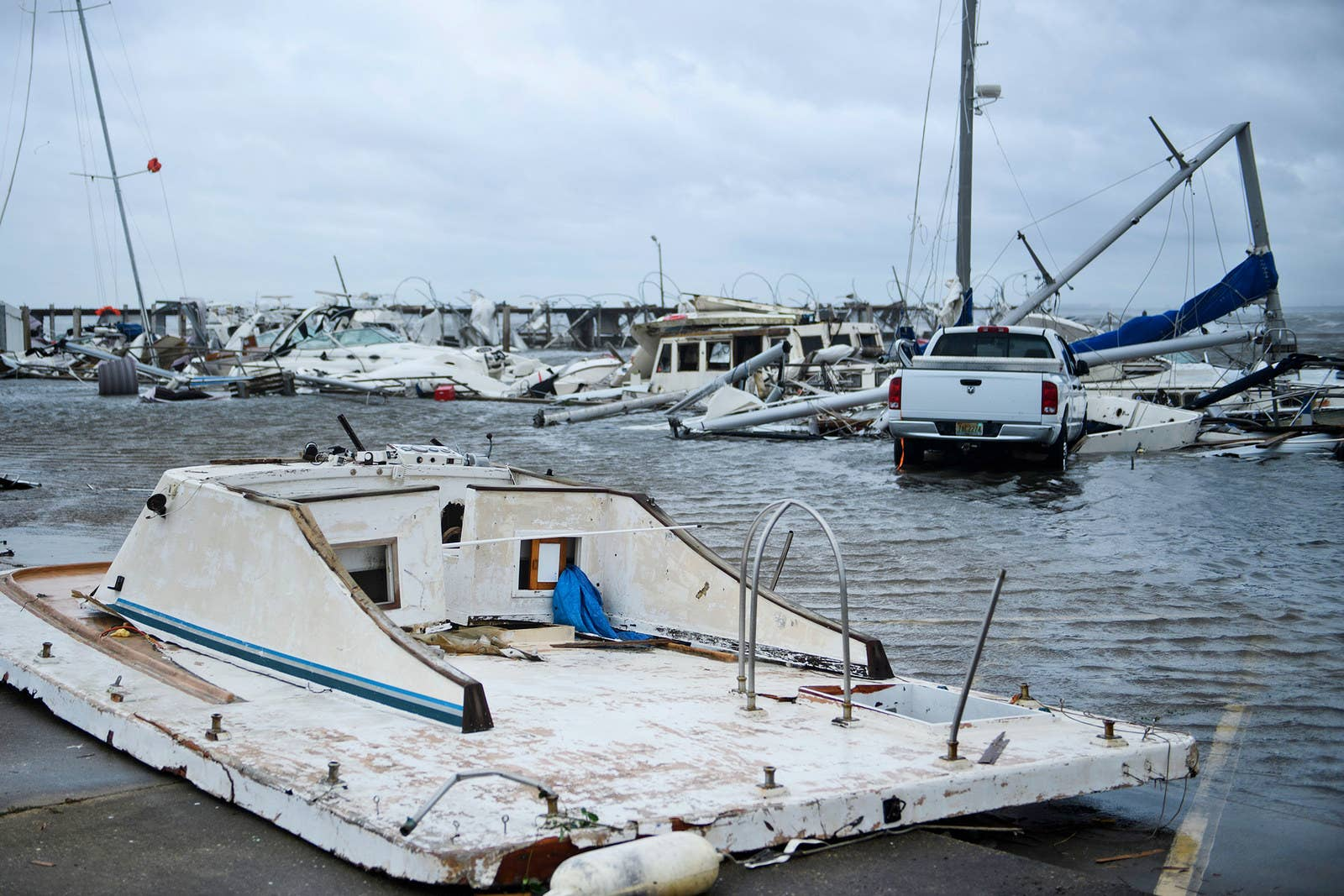 Damaged boats and a truck are seen in a marina in Panama City, Florida.