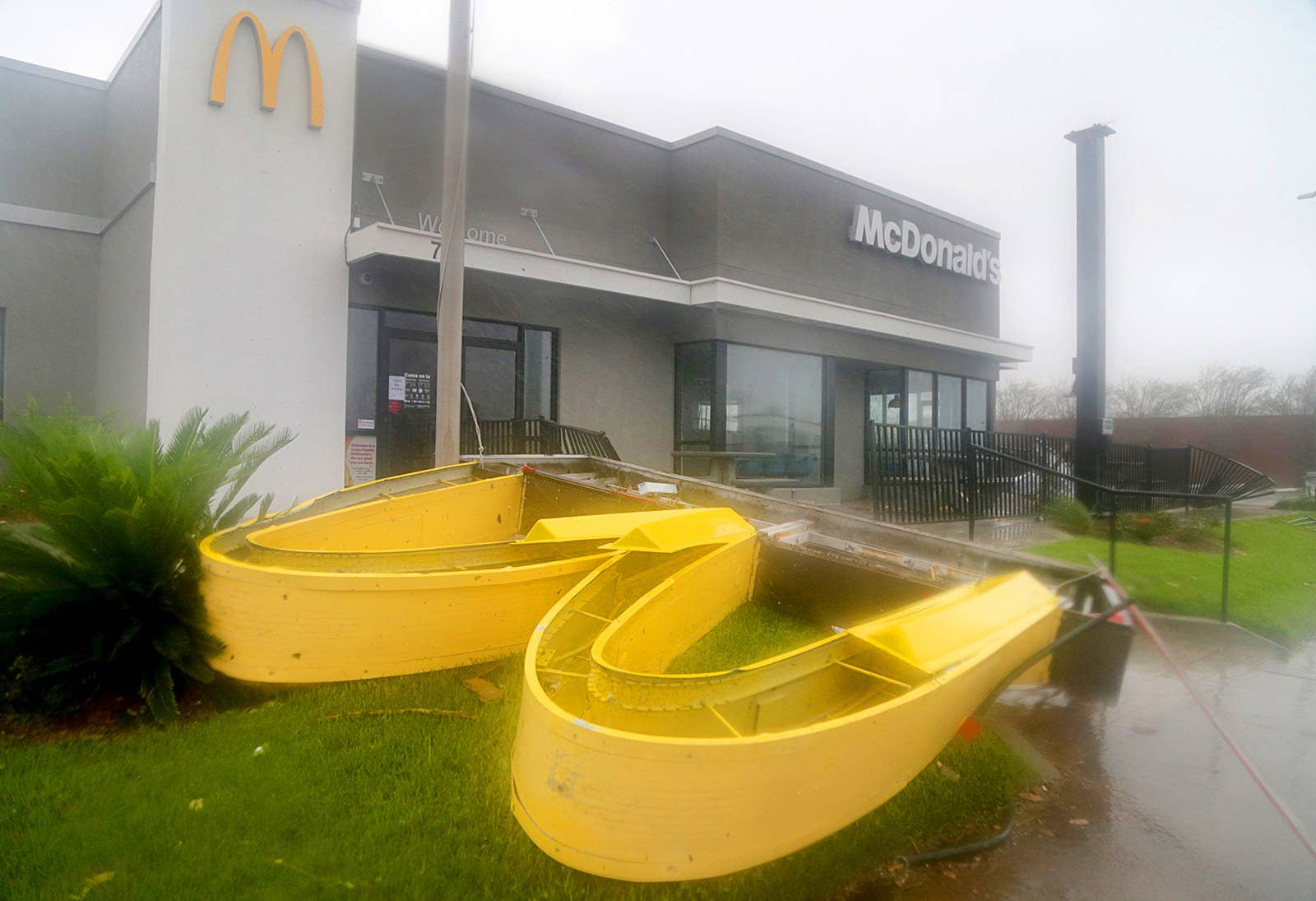 A McDonald's sign is toppled in Panama City, Florida.