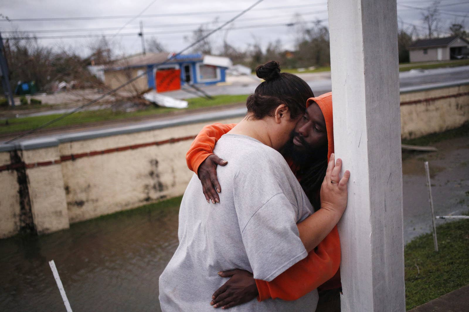 Residents embrace in front of their destroyed apartment building in Panama City, Florida.
