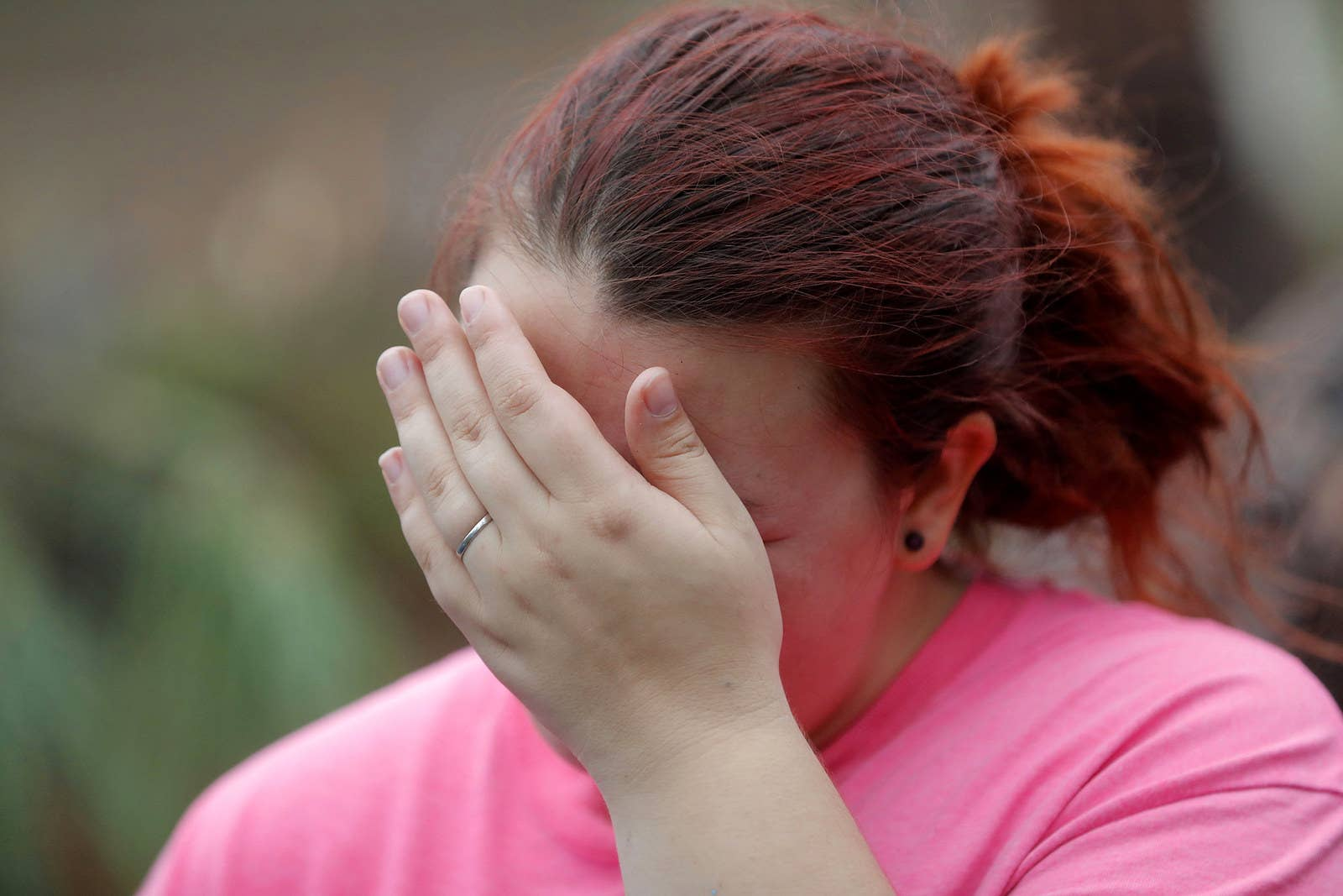 Kaylee O'Brian cries as she's unable to find her cat after several trees fell on her now-destroyed home in Panama City, Florida.