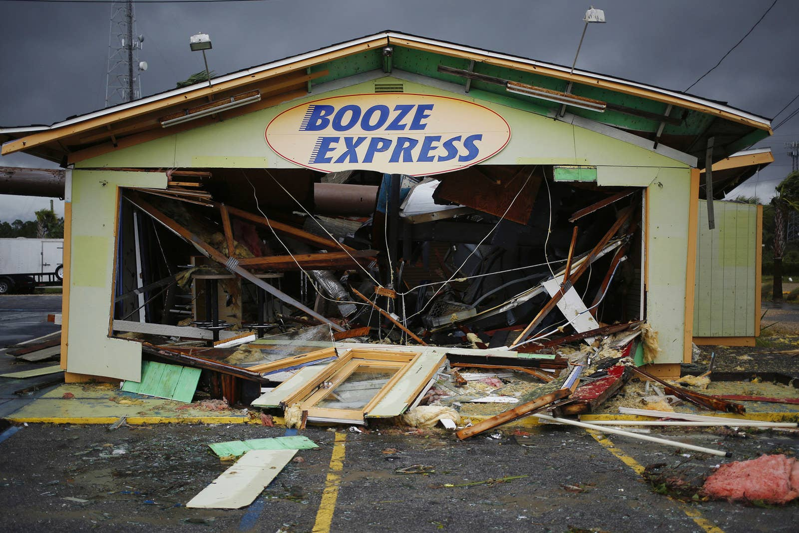 Debris lays on the ground of a Booze Express store in Panama City Beach, Florida.