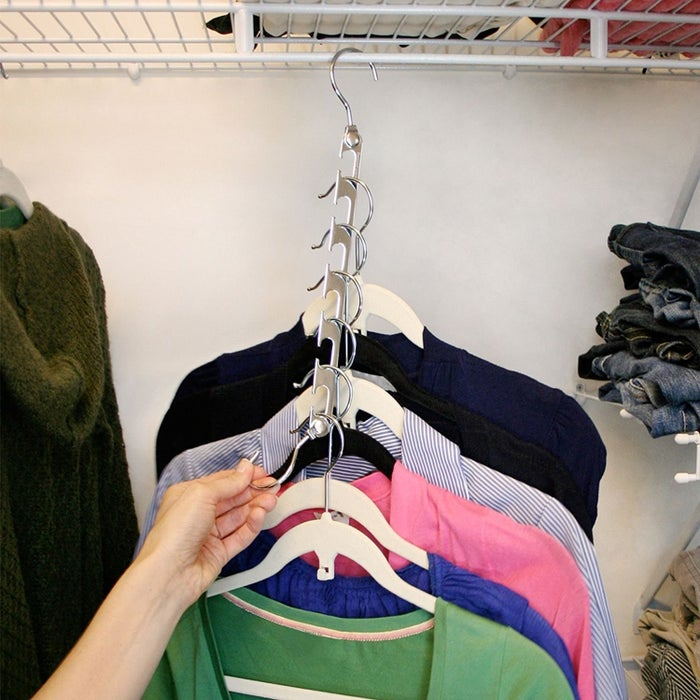 """Look how many pieces you can fit onto one hanger!!! Talk about space-saving. Promising review: """"I use these hangers for shirts and tees. They allow me to easily find any shirt in my closet and take up very little space compared to single shirts on single hangers. I can also group shirts together by style or color on a single swivel hanger. I am now able to hang additional items in my closet without crowding. I bought this in white and the edges are smooth."""" —CAGHGet them from Amazon for $19.99+ (available as a pack of four or five and in six colors)."""