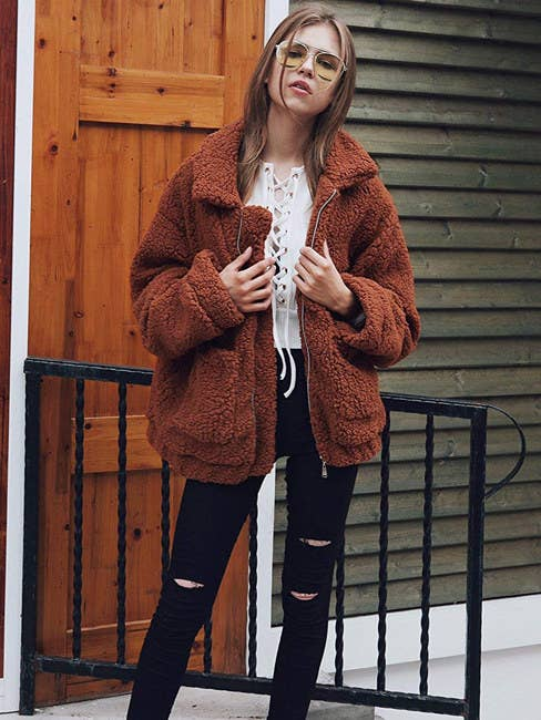 """If you want the jacket to fit oversized, it is recommended to size up from your normal size. Promising review: """"This jacket is so soft and warm, and the big pockets are a plus. Like other reviewers suggested, order a size up, so you can comfortably layer pieces under it. I usually wear a small but I got a medium, and it's perfect! I'll probably buy another in a different color."""" —BriannaPrice: $7.89+ (available in sizes S-3XL and 12 colors)"""