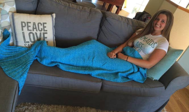 fa7f0f5e7353 A crochet mermaid tail blanket so you can be where the people are not — at  home on your couch.