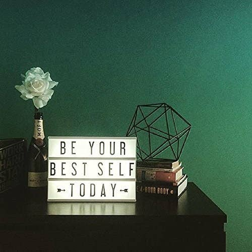 "An alphabet lightbox with the words ""Be Your Best Self Today"" on a table"