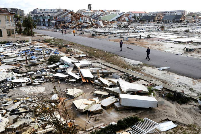 Rescue personnel search amid debris in the aftermath of Hurricane Michael in Mexico Beach, Florida, on Oct. 11.