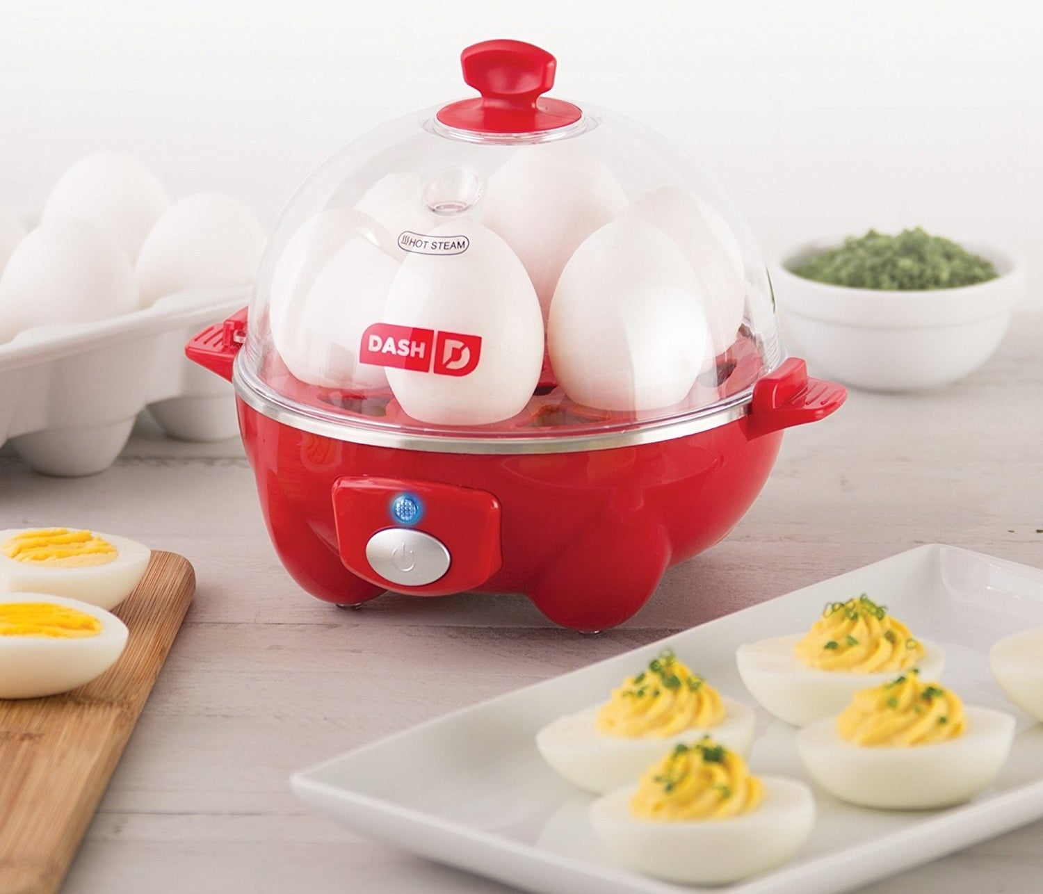 "Promising review: ""This thing is NO JOKE the easiest thing I've ever used in my life. Pretty sure it's idiot proof. And I'm an idiot in the kitchen. I love hard-boiled eggs, but I'm the kind of cooking-illiterate person who can't even boil water right. So I bought this puppy, read the directions carefully, got 6 eggs, and in 15 min, the buzzer went off and VOILA! Hard boiled eggs! I put them all in a bowl of ice water right after the buzzer went off, just for a minute or two (That was a tip in the instructions). That really made the shells come off easily. In one piece even! It was a joy to make these! They were perfectly cooked, nice and yellow in the centers, tasted awesome. I'm gonna make a bunch more and use them as quick snacks. This appliance is so great and cheap! I couldn't believe how well it worked. It's really small and all the pieces are plastic or metal, but it works like a charm, so who cares! A+++++ Highly recommended."" —EmilyGet it from Amazon for $15.05+ (available in five colors). Also check out the double-decker version."