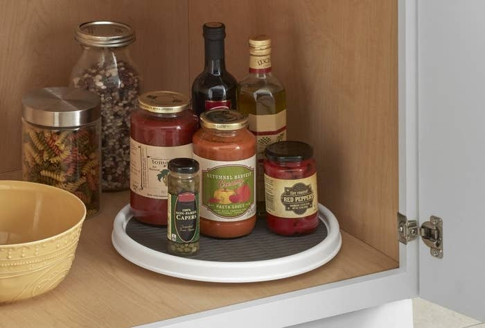 Sauces and wine placed on lazy susan in cabinet