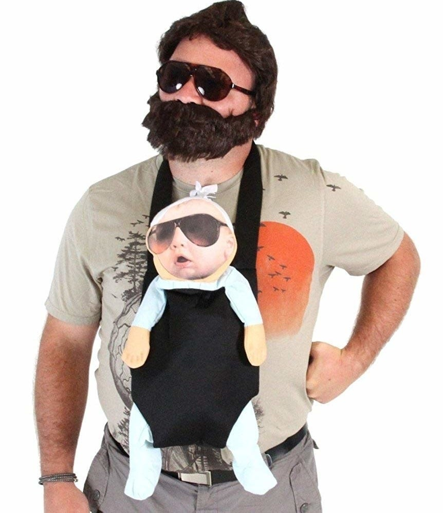 "In my wildest dreams, TBH, still holding out for a JoBros reunion. It comes with a T-shirt, a pair of glasses, a plush baby carrier, a wig, a beard, a mustache, and of course, a fake Baby Carlos with a screen printed face.Promising review: ""Yes, the baby is flat and a little strange looking, but that somehow adds to the crazy costume. I got lots of compliments walking around downtown Las Vegas, and several people stopped me to take pictures. Glad I found this, as it beats a lot of the generic costumes found at local Halloween shops."" —James C. WhitePrice: $49.95 (available in sizes S–3XL)"