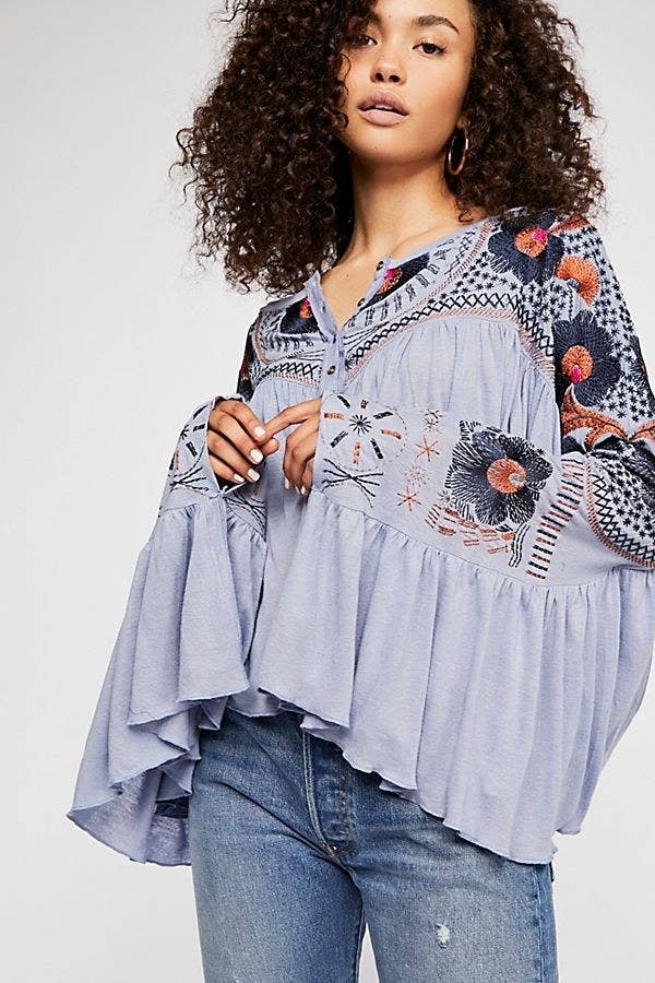 28e638b3 A floral top to remind you of spring and what's to come! Hang in there,  much like these sleeves.