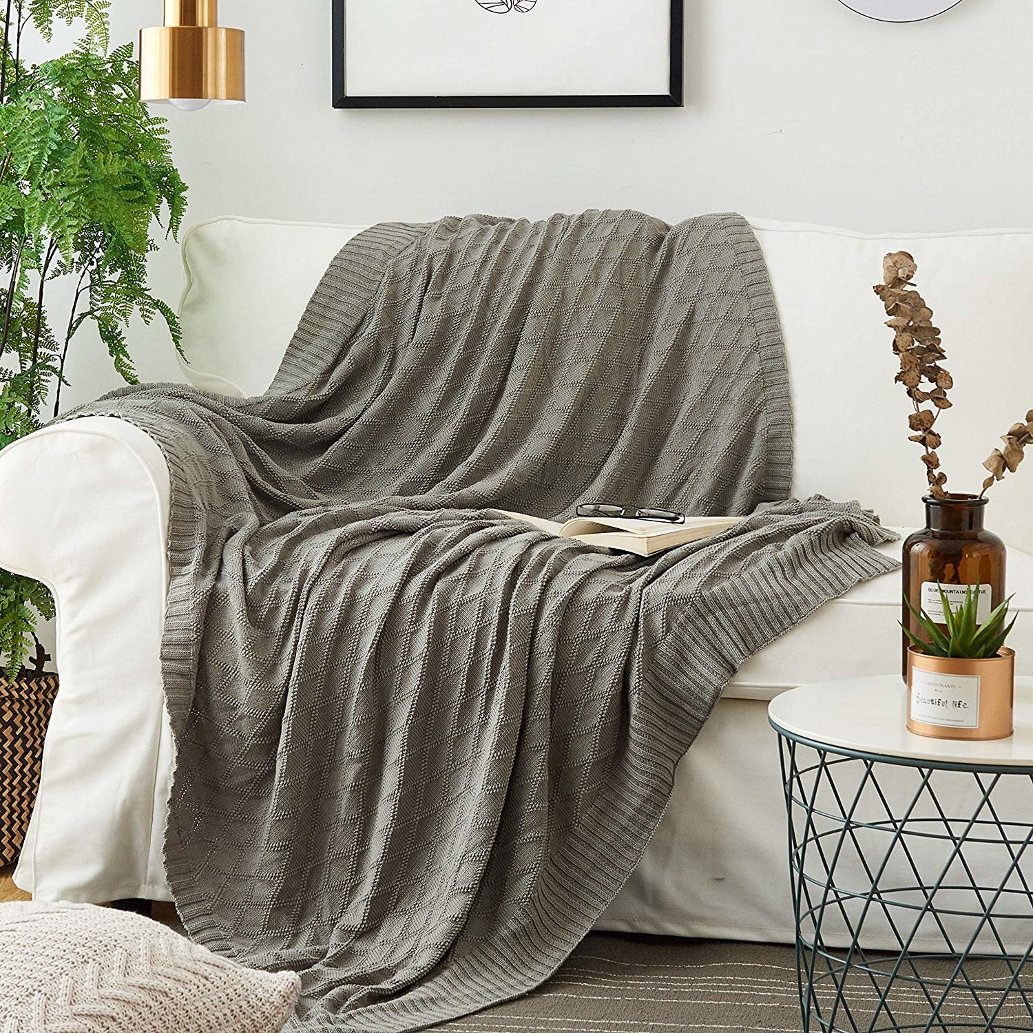 Cable-knit throw blanket over couch