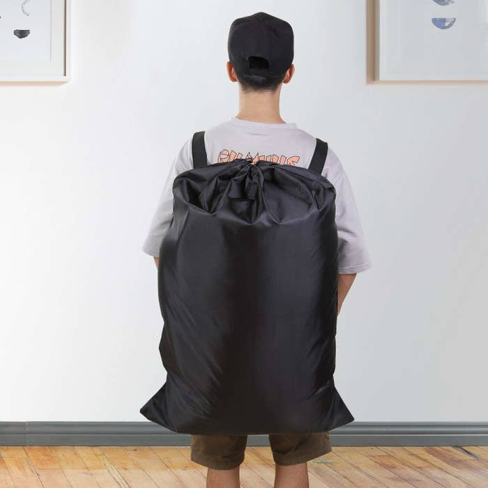 cfe2c51aa98a A laundry bag with shoulder straps that  might  encourage you to do some  washing once in a while.
