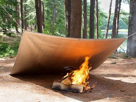 blanket-like cover over a fire