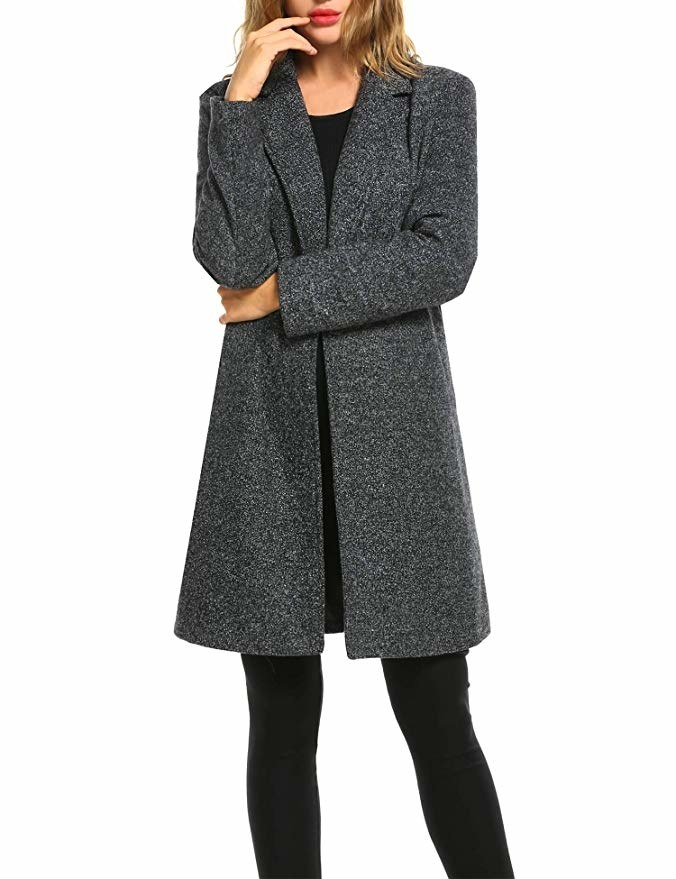 Model wearing the knee-length jacket with a large lapel collar in dark marbled grey.