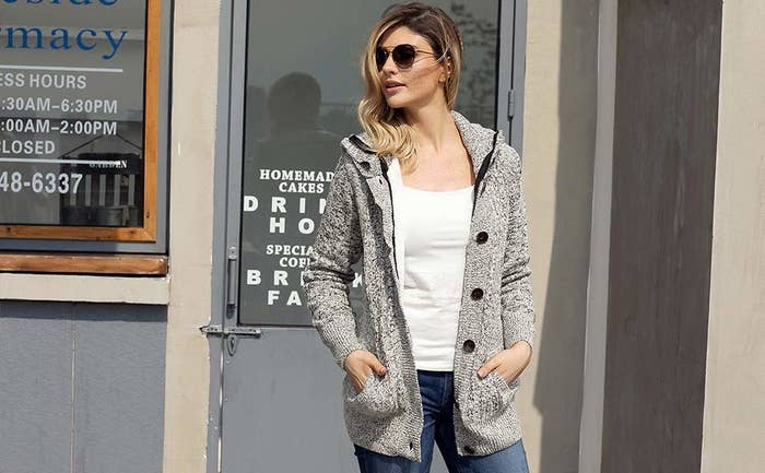 a2e225052741 A hooded, cable knit cardigan you'll be able to put underneath heavier  coats for extra warmth during the winter — or to just wear with a basic  tee, ...