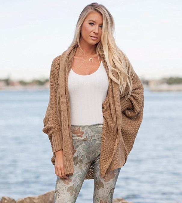 Model wearing the dolman-sleeved knit open cardigan in light brown.