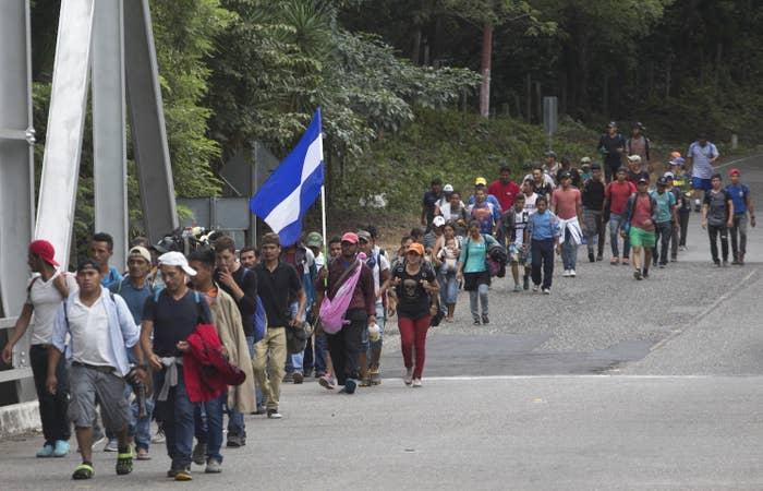 Honduran migrants walk in in Chiquimula, Guatemala, Tuesday as part of a caravan of hundreds of Honduran migrants making their way to the US.