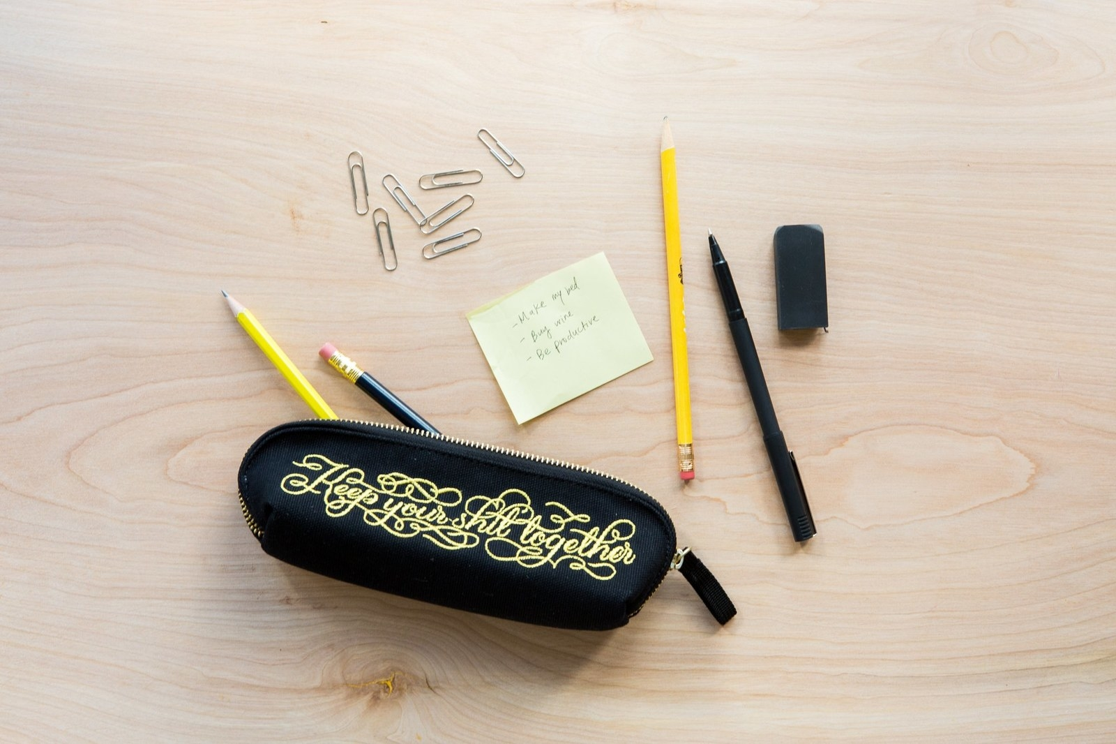 """Keep pens, pencils, erasers, basically all of your shit (just not the literal kind) together in this handy bag (which reads """"Keep your shit together,"""" for anyone struggling to read the ~fancy~ font).Get it from Amazon for $12.95."""