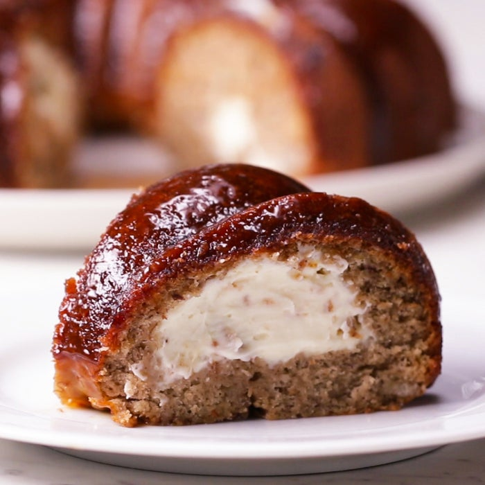 Ingredientsfor 10 servingsnonstick cooking sprayCHEESECAKE16 oz cream cheese, softened (450 g)½ cup powdered sugar (60 g)1 teaspoon vanilla extractBANANA BREAD4 ripe bananas1 ½ cups all-purpose flour (190 g)½ cup granulated sugar (100 g)1 teaspoon baking powder4 tablespoons vegetable oil1 egg1 teaspoon baking soda¼ teaspoon salt1 teaspoon cinnamon1 teaspoon vanilla extractCARAMEL1 cup granulated sugar (200 g)6 tablespoons butter½ cup heavy cream, room temperature (120 mL)PreparationPreheat the oven to 350°F (180°C). Grease a Bundt pan with nonstick spray.In a medium bowl, whisk together the cream cheese, powdered sugar, and vanilla, stirring until smooth. Refrigerate.In a large bowl, mash the bananas with a fork. Add the flour, sugar, baking powder, oil, egg, baking soda, salt, cinnamon, and vanilla. Stir until just combined, without overmixing. Pour half of the batter into the prepared Bundt pan.With an ice cream scoop, scoop the cream cheese mixture evenly onto the cake batter in the pan, making sure that it does not touch the sides. Pour the rest of the banana bread batter on top and smooth it evenly.Bake for 30 minutes, or until the banana bread is golden.To make the caramel glaze, heat the sugar in a medium saucepan over medium-high heat. Once it begins to melt, stir with a wooden spoon or whisk. When it reaches a boil, add the butter and stir until melted. Remove from the heat, add the heavy cream, and immediately stir until incorporated. (Make sure the cream is at room temperature or else it will curdle the sauce.) Allow the caramel cool and thicken.Invert the banana bread onto a wire rack set over a baking sheet.Pour the caramel glaze over the cake, letting the excess drip off. Once the glaze has set, slice the cake.Enjoy!