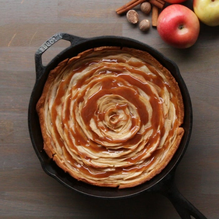 """Ingredientsfor 6 servings4 apples1 lemon, juiced½ cup granulated sugar (100 g)½ cup brown sugar (110 g)¼ teaspoon cinnamon¼ teaspoon nutmeg1 prepared pie dough¼ cup heavy cream (60 mL)PreparationPeel the apples and place them in a large bowl with enough water to cover. Squeeze lemon juice in the water to prevent the apples from browning. Working with 1 apple at a time, cut around the core, discarding the core and removing the """"cheeks."""" Slice the cheeks very thin.In a large bowl, combine the granulated sugar, brown sugar, cinnamon and nutmeg. Stir to combine. Add the sliced apples, stir to coat, and let sit for 30 minutes.Line a pie dough in a 9-inch (23-cm) cast-iron pan, and prick the dough with a fork all around. Chill in the fridge until very firm, 20-30 minutes.Working in batches, remove the apples from the cinnamon-sugar mixture by taking a handful at a time and carefully squeezing them with your hands to remove the excess moisture. Place the drained apples in a separate large bowl, reserving the liquid to make the caramel sauce.Preheat the oven to 375˚F (190˚C).Working from the outside in, line the apple slices on the pie dough by overlapping each slice to create a rose shape. Roll up 1 apple slice tightly and place it in the center, creating a bud shape. Cover the pan with foil and bake for 30 minutes. Uncover and bake for 10 minutes more, or until golden brown. Remove from the oven and let cool for 10 minutes.In a saucepan, bring the reserved cinnamon-sugar liquid to a boil. Once the liquid is reduced by half, 10-15 minutes, add the heavy cream and stir well.To serve, pour the caramel sauce over the apple pie.Enjoy!"""
