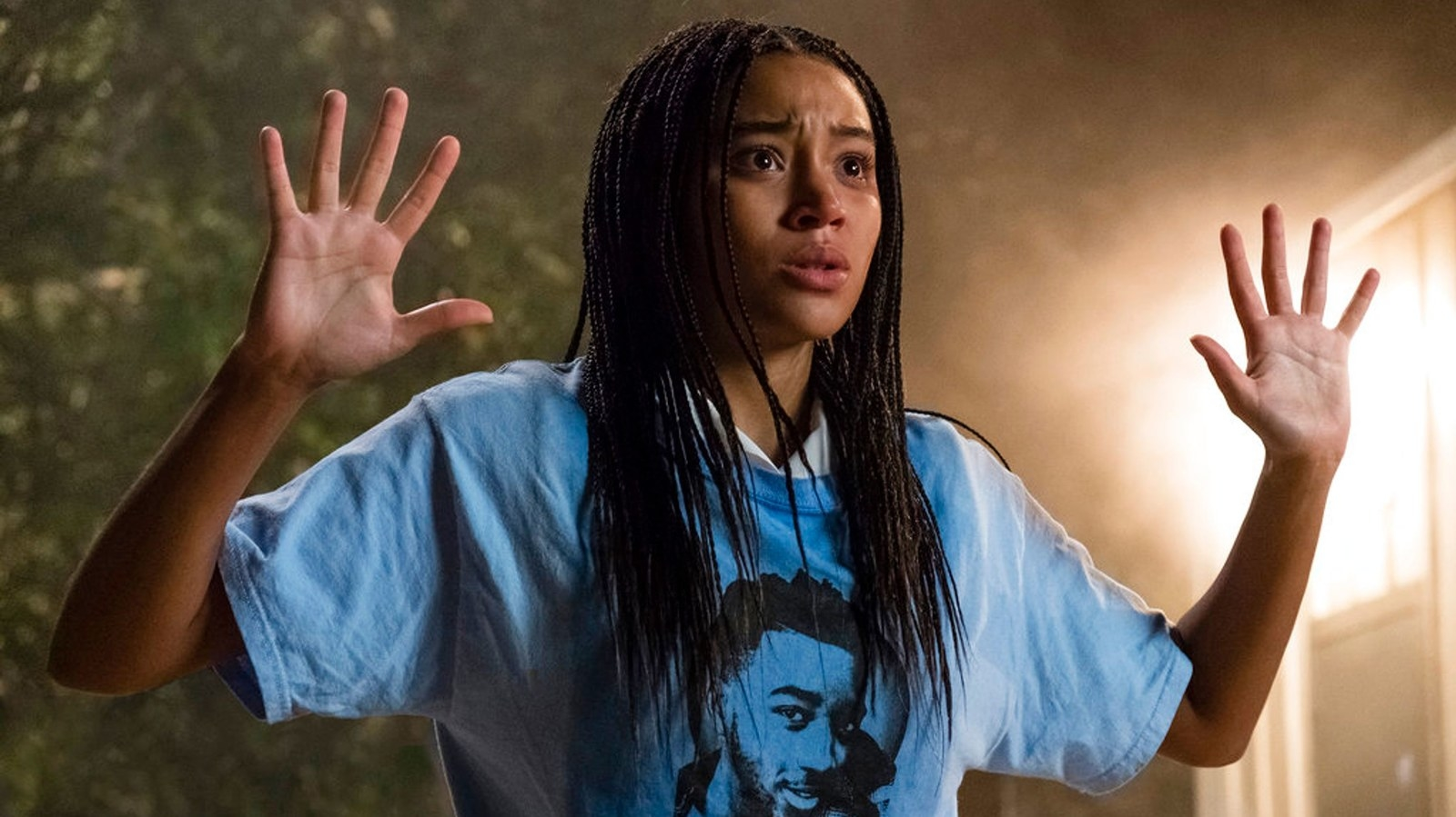 Starr facing the police with her hands up in The Hate U Give.