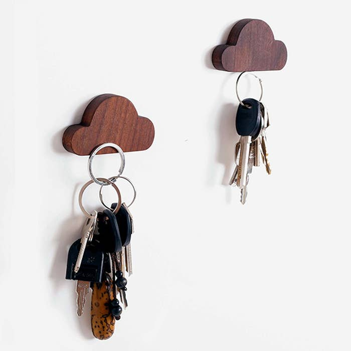 """Promising Review: """"This product is something that I didn't even know I needed! The magnet is more than powerful enough to hold my car and apartment keys simultaneously. In the past, I frequently misplaced my keys and this has provided me with an easy and convenient solution for just that. Now, I have one place to put my most important belongings. I appreciate the fact that it also can be applied to the wall — I've seen people use dishes before to hold their keys, but this was an awesome upgrade that I have truly come to love."""" —Amazon CustomerGet it on Amazon for $11.99+ (available in 13 different styles and finishes)."""
