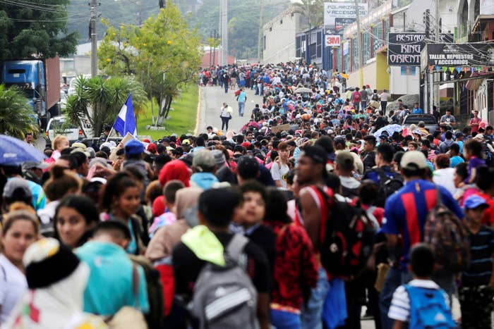 Thousands of Hondurans fleeing poverty and violence move in a caravan toward the United States, in Santa Rosa de Copan, Honduras, on Oct. 14.