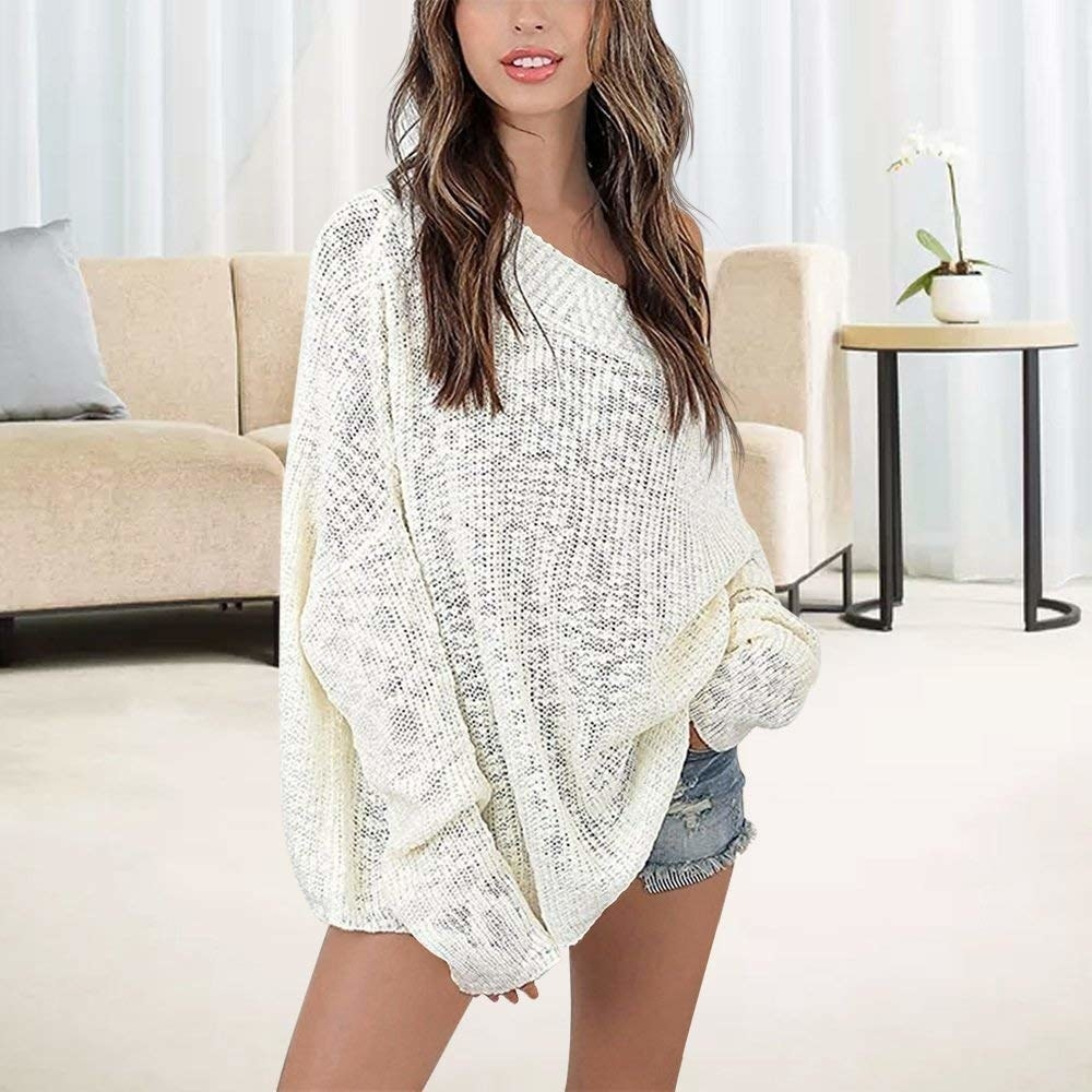 model wears oversized sweater with loose knit