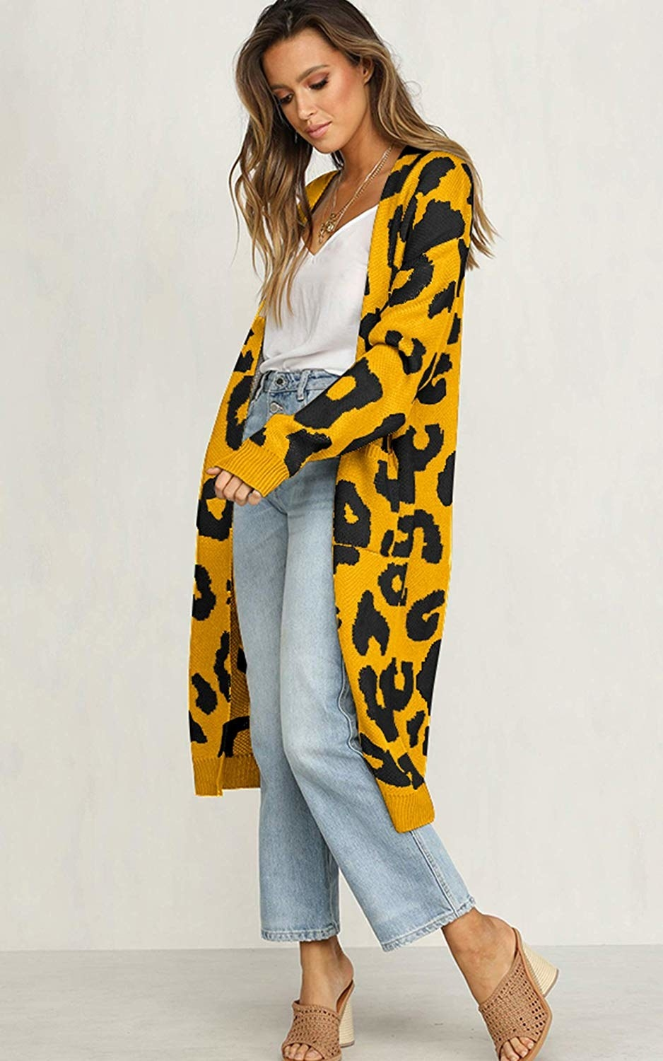 model wears cardigan with oversized leopard print