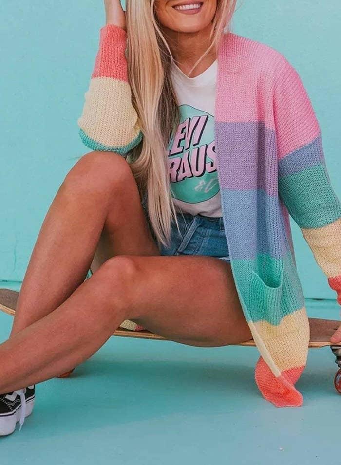 model wears rainbow cardigan