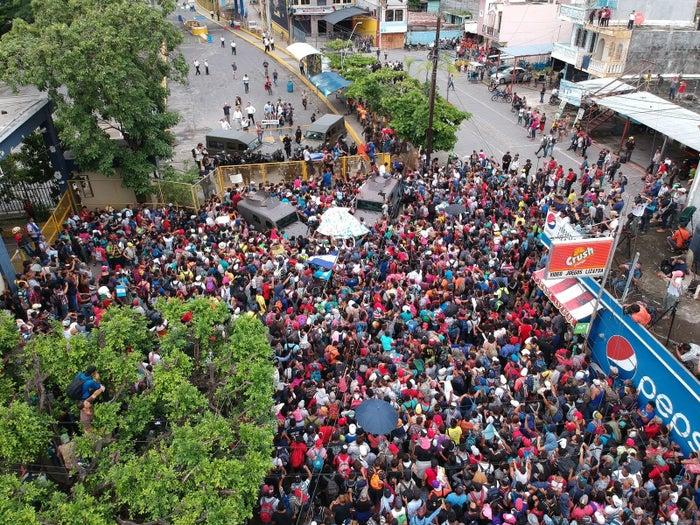 Aerial view of a Honduran caravan as it reached the Guatemala–Mexico international bridge in Tecun Uman, Guatemala.
