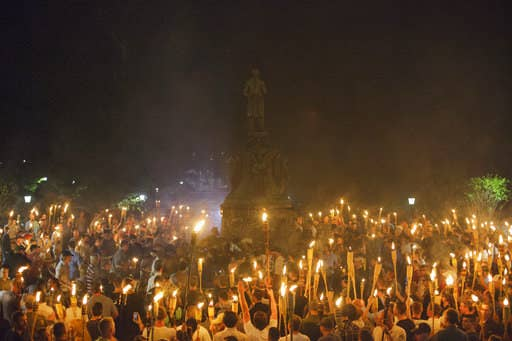 Neo-Nazi, alt-right, and white supremacist protesters encircle counterprotesters at the base of a statue of Thomas Jefferson after marching through the University of Virginia campus with torches in Charlottesville on Aug. 11, 2017.