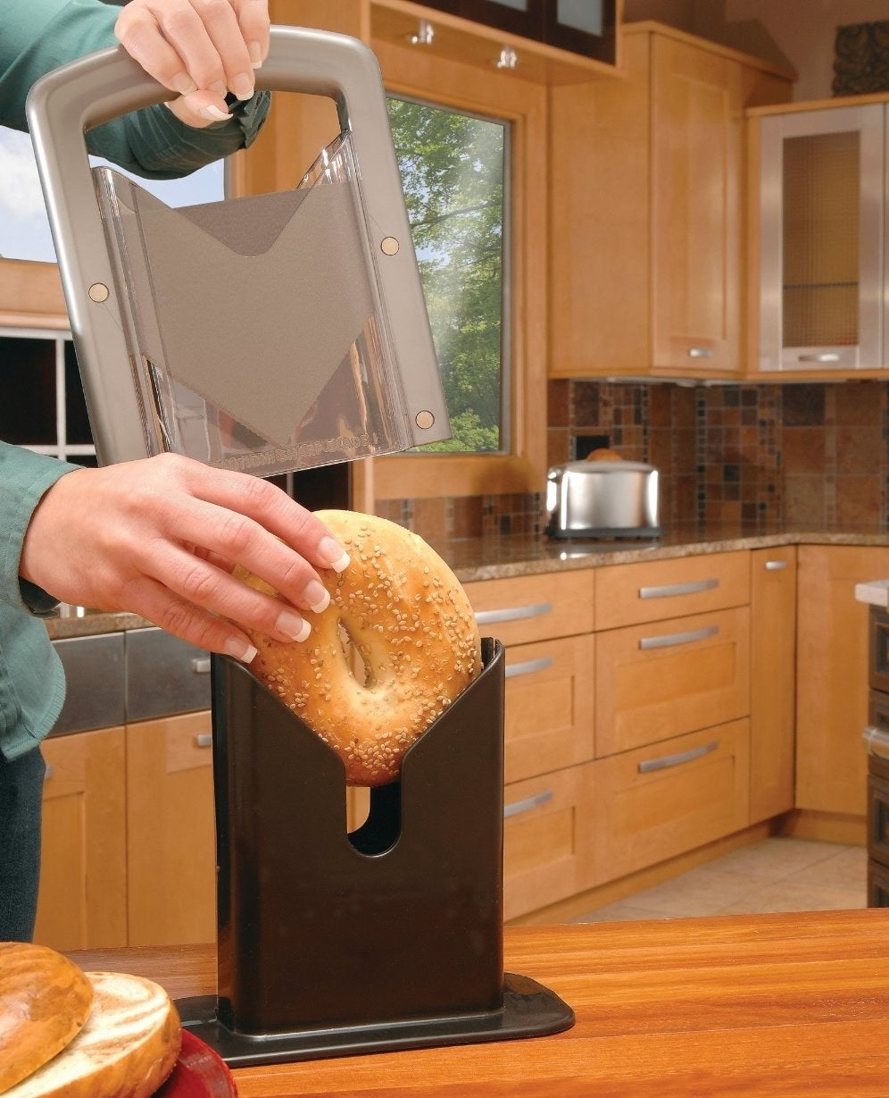 All you have to do is place your bagel in the cradle, push down rapidly, and there ya go. Your bagel is sliced! Get it from Walmart for $25.95.