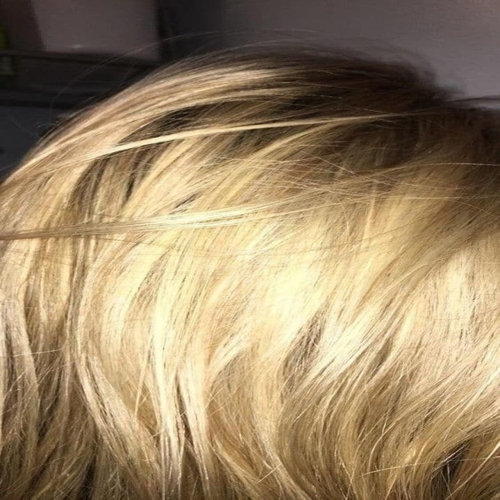 A reviewer with yellow-tone blonde hair