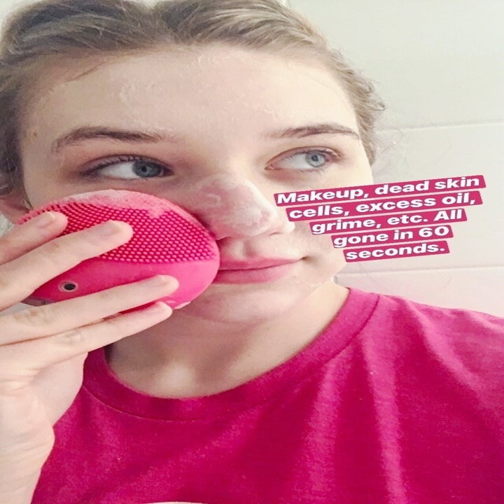 """Me using the Luna 2 on my face with face cleaner lathered on, with text """"makeup, dead skin cells, excess oil, grime, etc. All gone in 60 seconds"""""""