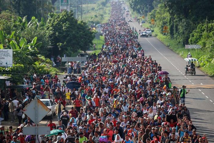 The caravan walks toward Tapachula from Ciudad Hidalgo on Oct. 21.