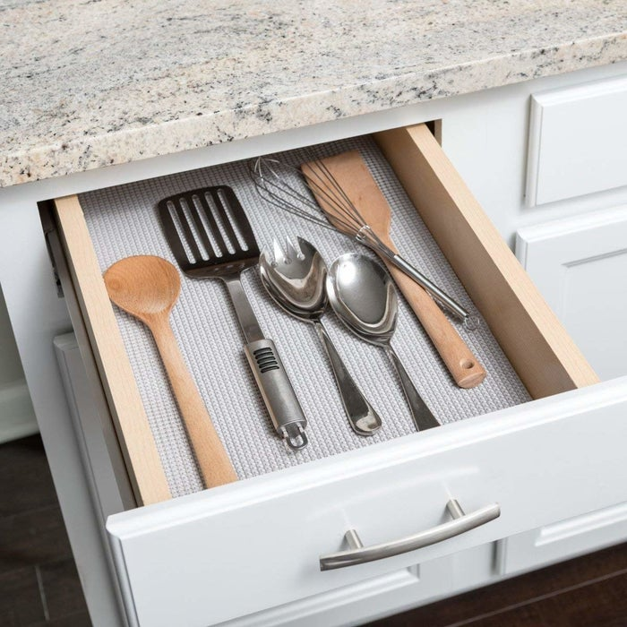 "Promising review: ""We moved into a new house with less than adequate shelving, and the first thing I did was clean the kitchen from top to bottom and line all the cabinets and drawers with liners. With the help of this product, I don't have to worry about my stuff sliding in drawers or touching the dirty shelves. That was the best thing I ever did. It was super easy to install so I also lined my cabinets and drawers in both my bathrooms."" —Mrs. HopefullyGet it from Amazon for $18.87 (available in six sizes and colors)."