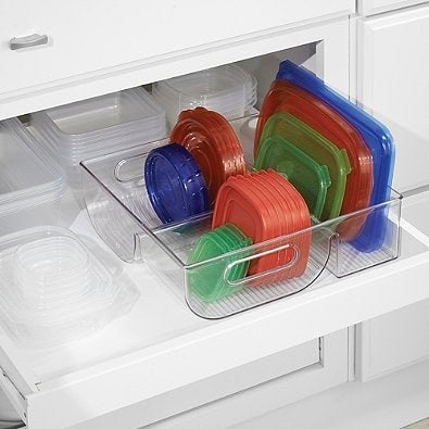 """Promising review: """"This is the best lid organizer I have ever had. At first, when you see it you might think it's too big. But how many containers with lids do you have? I just moved twice and downsized both times and still used most of the space it offered. Not only does it have enough space, but it also separates into three different sizes!! This makes it even easier to find the lid you need. Last but not least, the material is very sturdy. This isn't going to fall apart or break on you in a month or even a year! Get one for yourself and then stock up on them for Christmas gifts. They may not thank you right away, but they will when they start using this great organizer."""" —ShellyGet it from Amazon for $24.92."""