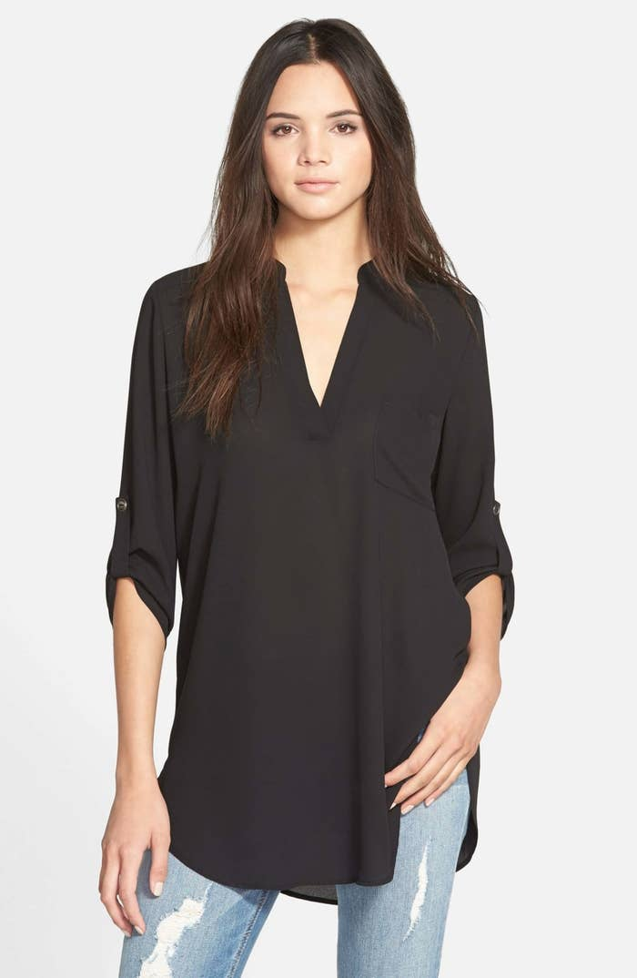 8a1dfff0e50 A chic tunic with roll-tab sleeves and over 3.9k reviews that'll be ~solid~  in more ways than one. (Dunno what to wear? This tunic will do you a solid.)