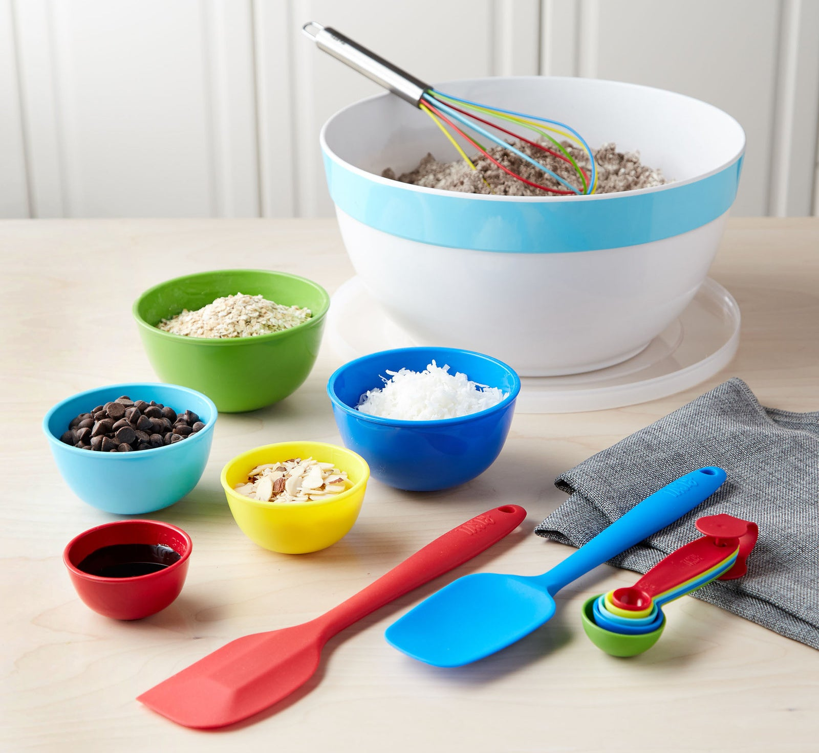 """Includes a 7 qt. mixing bowl with lid, a silicone spatula, a silicone whisk, a silicone spoonula, a five-piece measuring spoon set (one 1 tbsp., one 1/2 tbsp., one 1 tsp., one 1/2 tsp., and one 1/4 tsp.), and a five-piece measuring bowl set (with measurements ranging from 1/8 cup to two cups). Promising review: """"The colors are the first thing that drew me to this set. The fact that the utensils are silicone is a bonus! No more scraped cookware from my kids helping with their favorite recipes. Every kitchen needs this fun set of basics, especially if you have little ones who love to help."""" —EilujdGet it from BuzzFeed's Tasty collection at Walmart for $16.49 (originally $19.96)."""