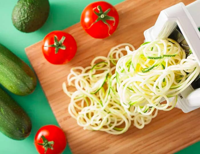 zucchini noodles coming out of the spiralizer