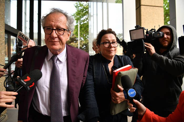 Geoffrey Rush and his wife Jane Menelaus leave court in Sydney on October 24.