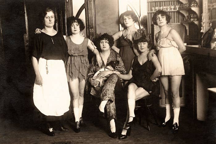 Sex workers in a brothel in France, circa 1910.