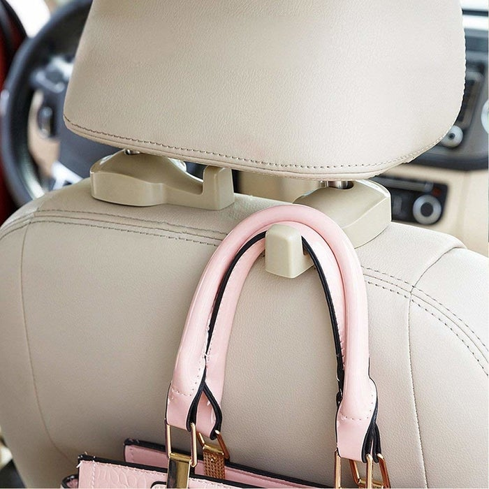 """Promising review: """"Where have you been all my driving life! This is so perfect to hang my purse on if someone is in the passenger seat. I can easily reach my bag, and it keeps the purse off of the car floor."""" —J. LewisGet a two-pack from Amazon for $7.95."""