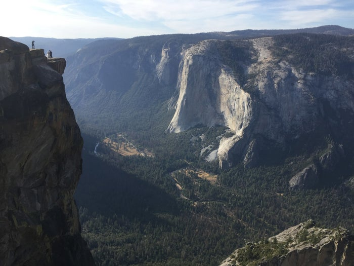 People gather at Taft Point (at left) in Yosemite.